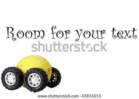 "generic truck wheels on a yellow lemon represents the catch phrase ""this car is a Lemon"" on silver - stock photo"