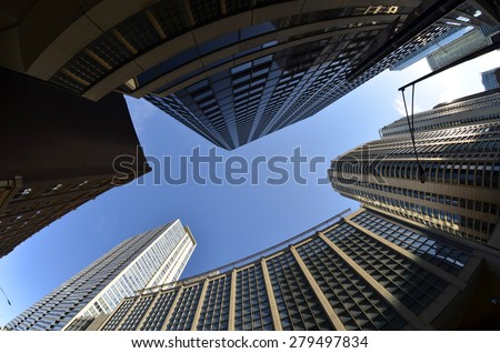 Generic urban landscape with tall buildings skyscrapers and sky with bird - stock photo