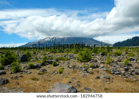 Generic view of the Mt. St. Helens volcano with a cloud hovering over the caldera. - stock photo
