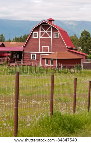 Generic wooden  farm house located in the countryside. - stock photo