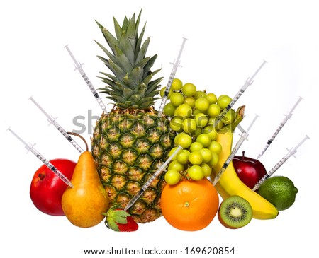 Genetically Modified Fruits isolated on white. Concept. Pineapple, Kiwi, Grapes, Banana, Apple, Mango, Pear, Strawberry and Lime. Genetic injection  - stock photo
