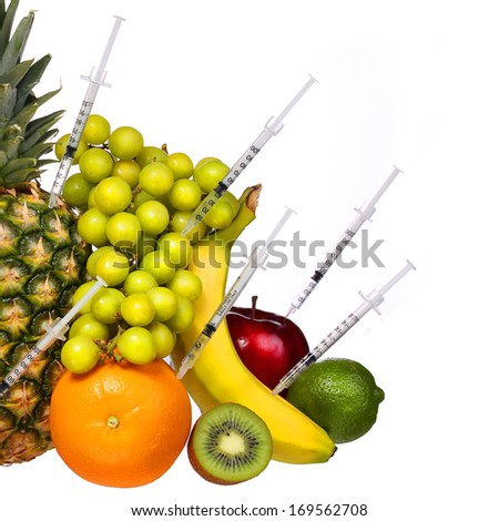 Genetically Modified Fruits isolated on white. GMO Concept. Pineapple, Kiwi, Grapes, Banana, Apple and Lime. Genetic injection  - stock photo