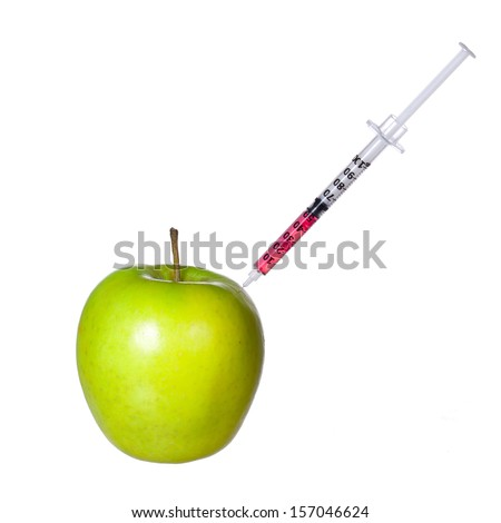 Genetically modified green apple and syringe isolated on white background. GMO food concept. Genetic injection - stock photo