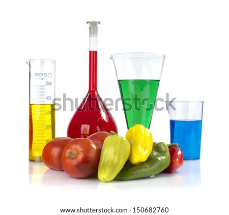 Genetically modified organism - ripe peppers,  tomatoes  and laboratory glassware on white background  - stock photo
