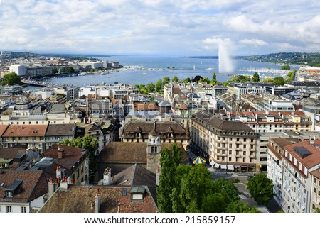 Geneva cityscape with roofs, houses, lake and fountain
