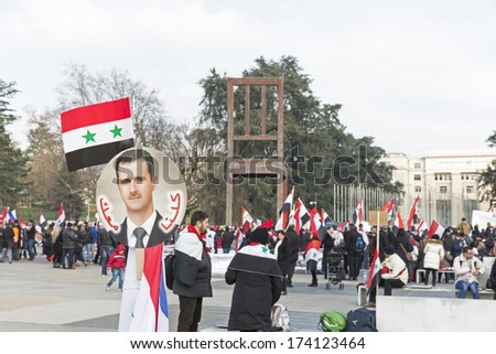 GENEVA � JANUARY 31: Unidentified demonstrators support President Bashar al -Assad of Syria outside the Geneva headquarters of the UN, January 31, 2014, Geneva, Switzerland. - stock photo