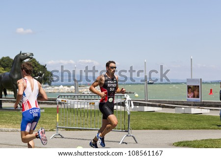 GENEVA - JULY 22: Athletes competing in the running section of the 2012 ITU Triathlon European Cup, July 22, 2012 in Geneva, Switzerland