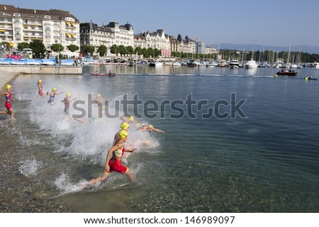 GENEVA - JULY 21: Unidentified athletes compete in the lake swim of the womens� race of the 2013 ITU Triathlon Continental European Cups, July 21, 2013 in Geneva, Switzerland.