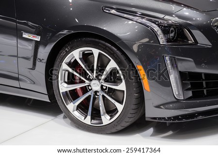 GENEVA, MAR 3: 2016 Cadillac CTS-V wheel and headlight details, presented at the 85th International Motor Show in Geneva, Switzerland on March 3, 2015. - stock photo