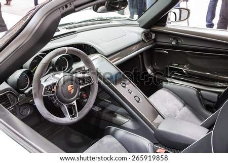 GENEVA, MAR 3: Porsche 918 Spyder car interior, presented at the 85th International Motor Show in Geneva, Switzerland on March 3, 2015. - stock photo