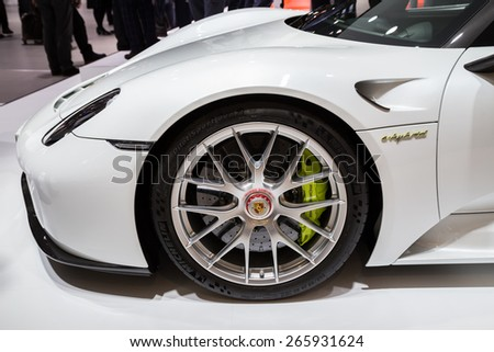 GENEVA, MAR 3: Porsche 918 Spyder car wheel and headlight details, presented at the 85th International Motor Show in Geneva, Switzerland on March 3, 2015. - stock photo