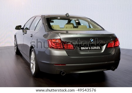 GENEVA - MARCH 3: BMW 5 series new launch at the 80th International Motor Show on March 3, 2010 in Geneva, Switzerland - stock photo