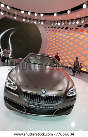 GENEVA - MARCH 16 : Brown BMW Gran Coupe 6 series on display at the 82st International Motor Show Palexpo -Geneva on March 16; 2012 in Geneva, Switzerland. - stock photo