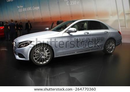 GENEVA, MARCH 3: Mercedes Benz C350 E car on display at 85th international Geneva motor Show at Palexpo-Geneva on March 3, 2015 at Geneva, Switzerland. - stock photo