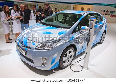 GENEVA - MARCH 8: The Toyota Prius plug-in hybrid preview on display at the 81st International Motor Show Palexpo-Geneva on March 8; 2011 in Geneva, Switzerland. - stock photo