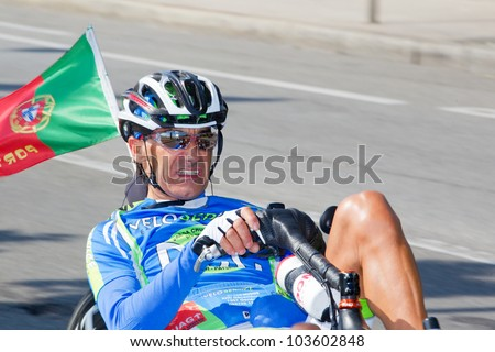 GENEVA - MAY 27: Unidentified athlete competing in the 2012 Cyclotour of Lake Geneva, May 27, 2012 in Geneva, Switzerland. The Cyclotour consists of three races of 180km, 110 and 60km. - stock photo
