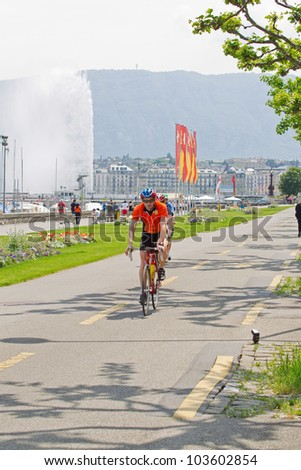 GENEVA - MAY 27: Unidentified athlete competing in the 2012 Cyclotour of Lake Geneva, May 27, 2012 in Geneva, Switzerland. The Cyclotour consists of three races of 180km, 110 and 60km.