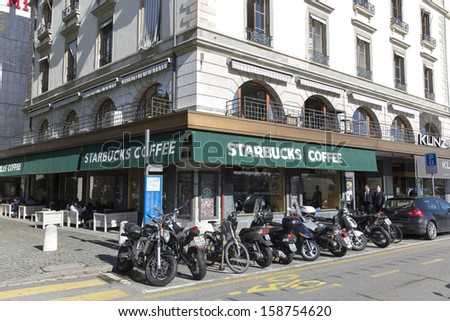 GENEVA � OCTOBER 17: An outlet of Starbucks October 17, 2013, Geneva, Switzerland. It is the largest coffeehouse company in the world, with 20,891 stores in 62 countries.  - stock photo