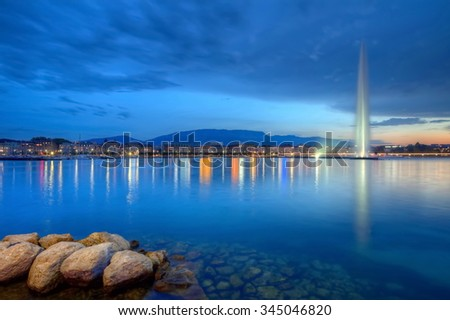 Geneva panorama with famous fountain by night, Switzerland, HDR - stock photo
