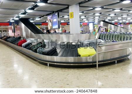 GENEVA - SEP 15: Baggage claim area on September 15, 2014 in Geneva, Switzerland. Geneva International Airport is the international airport of Geneva, Switzerland - stock photo
