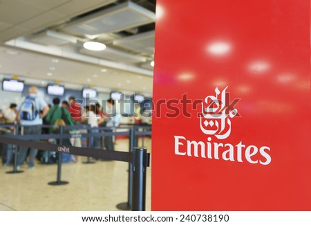 GENEVA - SEP 16: Emirates check-in area on September 16, 2014 in Geneva, Switzerland. Emirates is the flag carrier of the United Arab Emirates along with Etihad Airways and is based in Dubai - stock photo