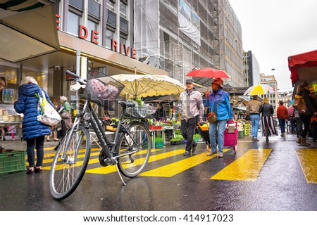 Geneva, Switzerland - April 16, 2016 : People park the bicycle while they go shopping at street market in Geneve, Switzerland