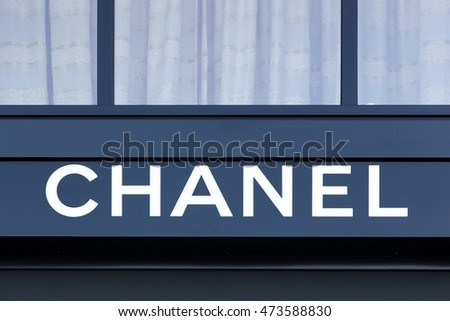 Geneva, Switzerland - August 14, 2016: Chanel logo on a wall. Chanel is a French high fashion house that specializes in haute couture and ready-to-wear clothes, luxury goods and fashion accessories