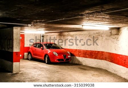 GENEVA, SWITZERLAND - AUGUST 4, 2014: Motor car Alfa Romeo MiTo at the underground parking. - stock photo