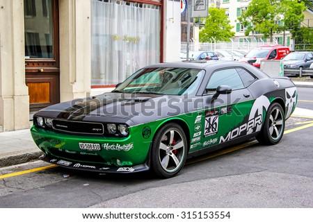 GENEVA, SWITZERLAND - AUGUST 4, 2014: Motor car Dodge Challenger at the city street. - stock photo