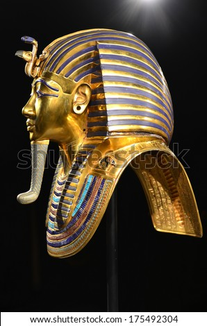 GENEVA, SWITZERLAND - DECEMBER 17: Tutankhamun's death mask in profile at the Tutankhamun exhibition :  December 17, 2013 in Geneva Switzerland - stock photo