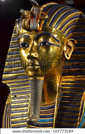 GENEVA, SWITZERLAND - DECEMBER 17: Tutankhamun's magnificent golden death mask at the Tutankhamun exhibition :  December 17, 2013 in Geneva Switzerland - stock photo