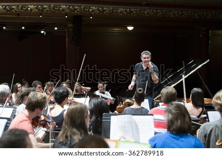 GENEVA, SWITZERLAND JUNE 13, 2015: Antoine Marguier conducts the UN Orchestra at rehearsals for a concert in aid of Syrian refugees at the Victoria Hall.