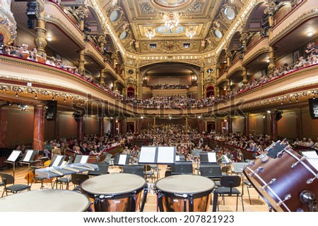 GENEVA, SWITZERLAND - JUNE 22, 2014: The audience awaits the United Nations Orchestra the concert performance at the Victoria Hall during a free concert as part of the city's festival of music.