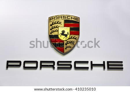 GENEVA, SWITZERLAND - MARCH 2, 2016: A Porsche sign at the Geneva Motor Show. Porsche is owned by Volkswagen AG.