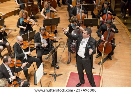 GENEVA, SWITZERLAND MARCH 20, 2013: Antoine Marguier conducts the United Nations Orchestra at the Tchaikovsky spring concert at the Victoria Hall. - stock photo