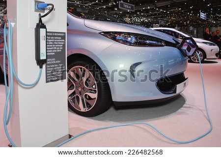 GENEVA, SWITZERLAND - MARCH 4, 2014: Renault ZOE EV and charging station on display during the Geneva Motor Show.
