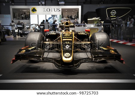 GENEVA SWITZERLAND - MARCH 12: The Lotus Stand displaying the 2011 Lotus Racing F1 Car, in John Player Special Colours, at the Geneva Motorshow on March 12th, 2012 in Geneva, Switzerland.