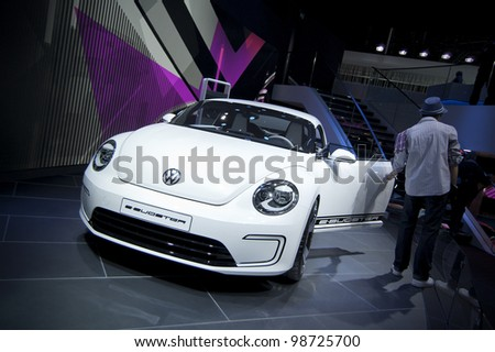GENEVA SWITZERLAND - MARCH 12: The Volkswagen Stand displaying a overhead rear view of their new Beetle Roadster Concept, at the Geneva Motorshow on March 12th, 2012 in Geneva, Switzerland. - stock photo
