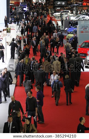 Geneva, Switzerland - March 4: Visitors from all over the world visits PalExpo during 80th Geneva Motor Show to see more than 150 world and European new car models premiers on March 4, 2010 in Geneva