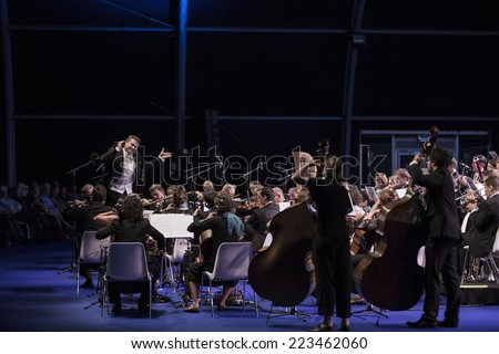 GENEVA, SWITZERLAND -SEPTEMBER 19, 2014: The UN Orchestra conducted by Antoine Marguier performs at the 60th anniversary of CERN, the European Organization for Nuclear Research - stock photo