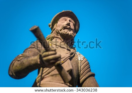 GENGENBACH, GERMANY - SEPTEMBER 6, 2014: The Stony Knight on the Roehr Fountain in Gengenbach, Black Forest, Baden-Wuerttemberg, Germany, Europe - stock photo