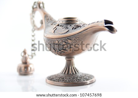Genie lamp also called Aladdin lamp with pharaonic symbols - stock photo