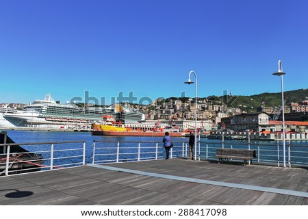 Genoa harbor promenade - stock photo