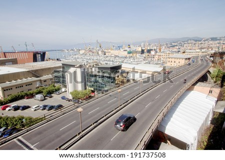 GENOA, ITALY - APRIL 9, 2014: panoramic view of the Genoa harbor and the famous highway that passes in the heart of the city