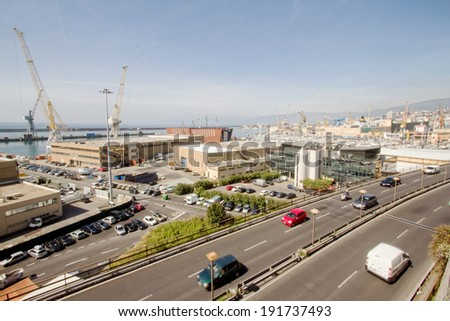 GENOA, ITALY - APRIL 9, 2014: panoramic view of the Genoa harbor ant the famous highway that passes in the heart of the city