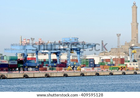 GENOA, ITALY - APRIL 21, 2016: the quay of the SECHC terminal with containers and cranes. In the picture, on the right, the lighthouse of the port of Genoa.