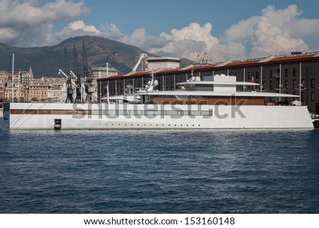 GENOA, ITALY - AUGUST, 28: Steve Jobs' luxury yacht in the port on August 28, 2013 in Genoa. Designed by Philippe Starck it is a 260 feet super yacht featuring state-of-the-art aluminum hull. - stock photo