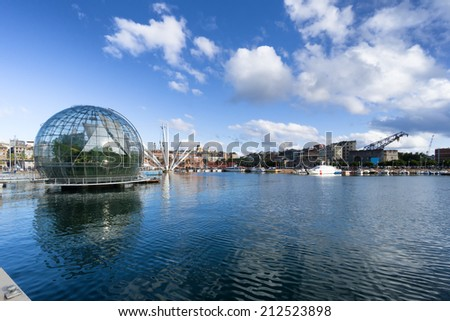 GENOA, ITALY - AUGUST, 23: The old harbor on August 23, 2014 in Genoa. The harbor of Genoa is the busiest port of Italy and one of the most important in the Mediterranean area. - stock photo