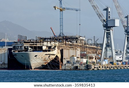 GENOA, ITALY - DECEMBER 1, 2015: the wreck of Costa Concordia is demolished in dry dock at the shipyard San Giorgio. In the picture, the hull without the upper decks.