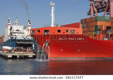 GENOA, ITALY - FEBRUARY 5, 2016: Ro-Ro Container ship Jolly Palladio of Messina line in the port of Genoa